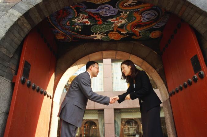 Businessman-Businesswoman-Shake-Hands-PhotosCom-71018805-John-Foxx-676x450